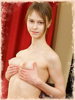 Adorable Beata getting naked in front of the camera