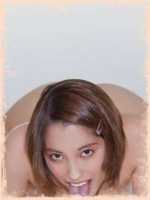 Naughty Kaylee teasing on the floor naked sucking her big glass dildo