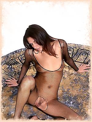 Gabriella in a black fishnet body stocking