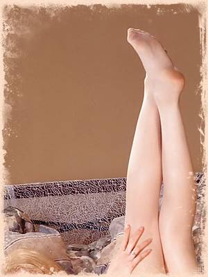 Leggy babe Courtney in sexy white stockings